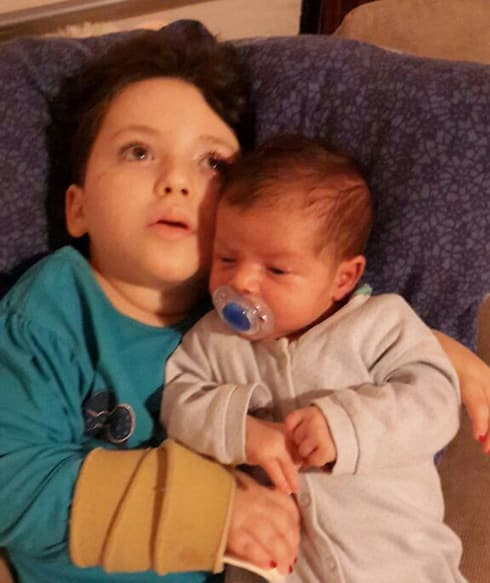 "Adele holding her baby brother, a few days before she died, HY""D."