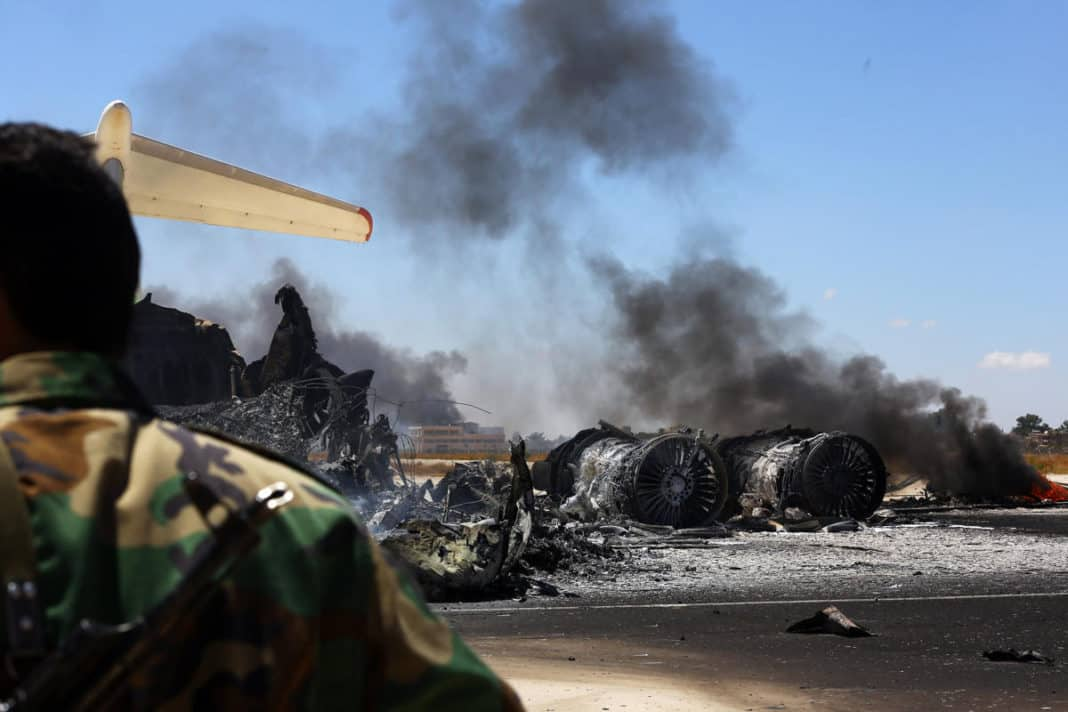 This is not Ben Gurion Airport. The remains of a burnt airplane is pictured at the Tripoli international airport in the Libyan capital on July 16, 2014
