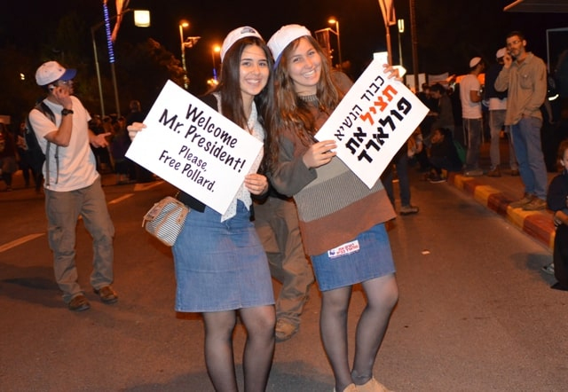 protest banners held by two girls