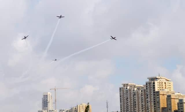 Four planes flying over skyline