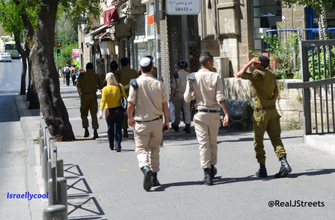 Israeli soldiers walking near Arab girl