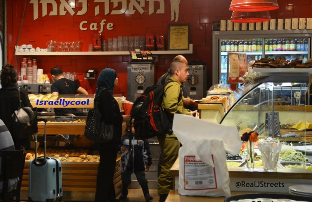 image Israeli solider and Arab man and woman