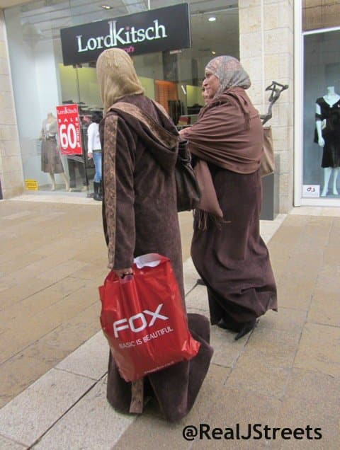 image Arab women with red Fox shopping bags