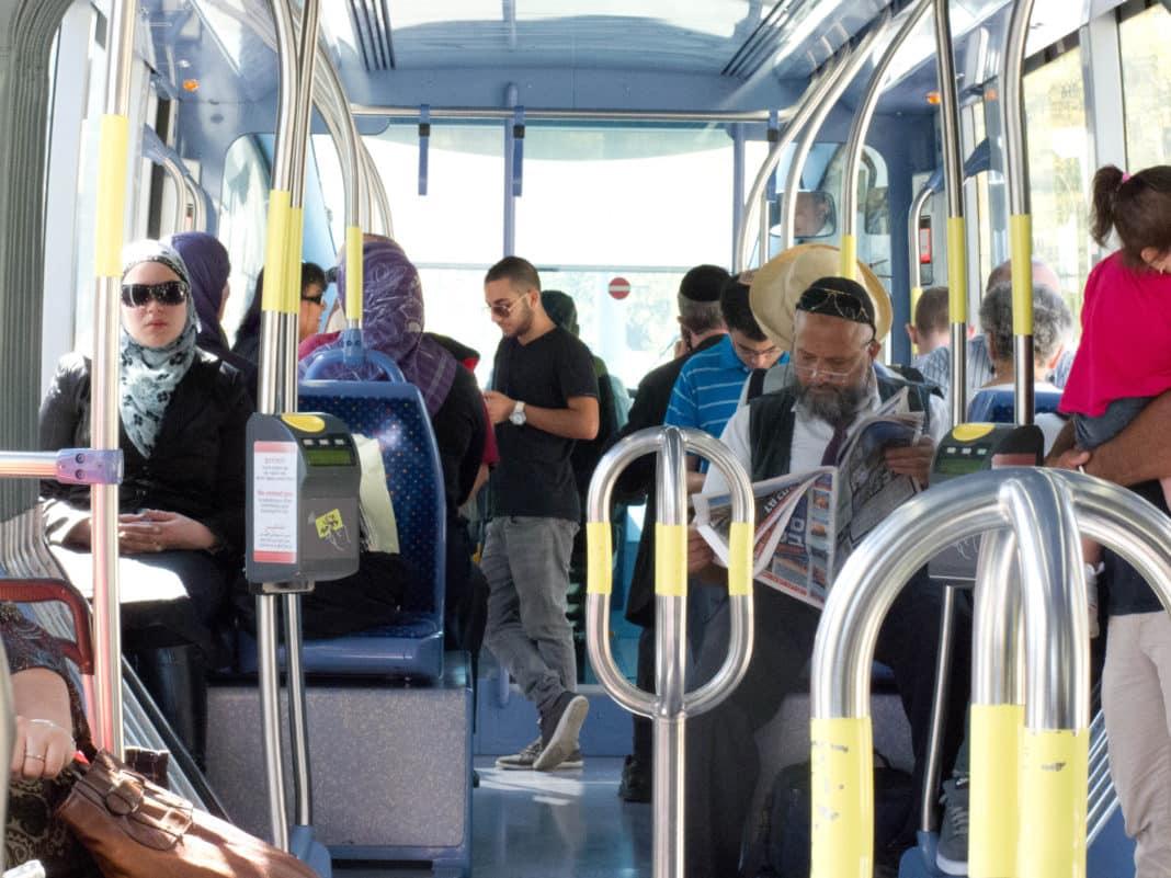 Israelis of all backgrounds traveling side-by-side on Jerusalem's light rail.