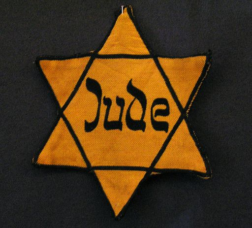 "Yellow badge Star of David called ""Judenstern"". Part of the exhibition in the Jewish Museum Westphalia, Dorsten, Germany. The wording is the German word for Jew (Jude), written in mock-Hebrew script.(Photo: CC-BY-SA Daniel Ullrich, Threedots, Wikipedia)"