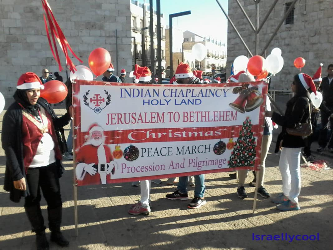 image Indian workers in Santa hats at Jaffa Gate