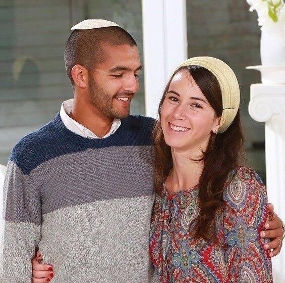 """Sergeant Yanai Weissman (HY""""D) and wife Yael Weissman."""