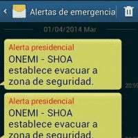 Screen shot of a real phone alert from Chile telling people to evacuate.