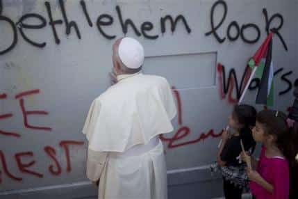 "From the AP: ""Pope Francis prays at Israel's separation barrier on his way to a mass in Manger Square next to the Church of the Nativity, traditionally believed to be the birthplace of Jesus Christ in the West Bank city of Bethlehem on Sunday, May 25, 2014. Francis called the Israeli-Palestinian stalemate ""unacceptable"" as he landed Sunday in the West Bank town of Bethlehem in a symbolic nod to Palestinian aspirations for their own state. "" (AP Photo/Ariel Schalit)"