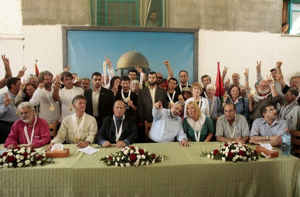 """International activists meet with senior Hamas leader Ismail Haniyeh at his house after they arrived in Gaza August 24, 2008. Two boats carrying activists challenging an Israeli blockade on the Gaza Strip reached the shore of the Hamas-controlled territory on Saturday. The 44 """"Free Gaza"""" activists from 17 nations, who had set out on Friday from Cyprus in two wooden boats, were met by thousands of Palestinians who cheered along the shoreline at their arrival. REUTERS/Mohammed Salem (GAZA)"""