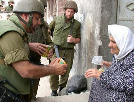 idf helping palestinian woman