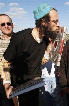 Israeli man kissing Quran - AP