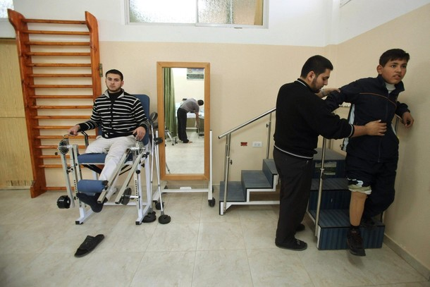 Palestinians with lost legs - Reuters