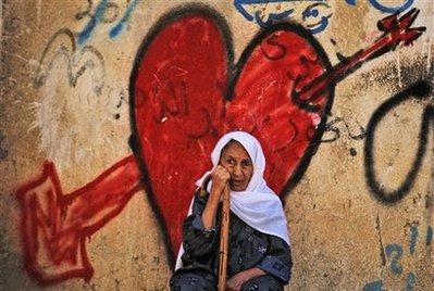 Palestinian woman heart mural AP