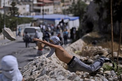 palestinian protester rock