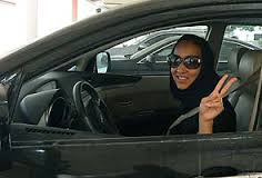 A Saudi woman driver making an evil gesture