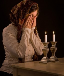 woman-lighting-candles-256x300